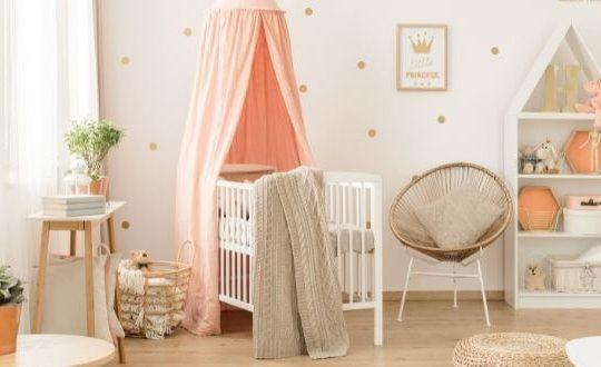 scandinavian style nursery in peach and beige