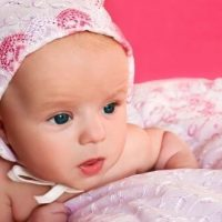 newborn girl with pink hat